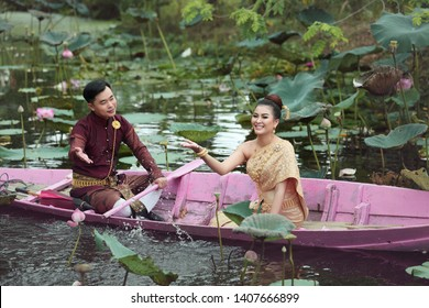 asian bride. Bride and groom with boat. Couple romantic lake. Asian woman. Beautiful bride in Thai culture dress. Chiang Mai, Phuket. Amazing Thailand. Laos bride. Thai dress. Asian woman Happy smile