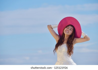 asian  bride with a veil on the beach in the sky and blue sea. honeymoon on the fantastic island at summer