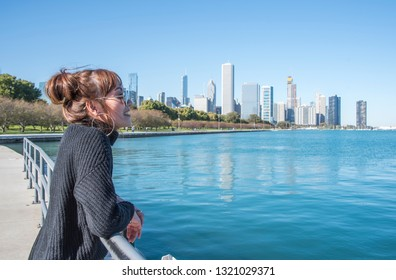 Asian Buisnesswomen standing in the City of Chicago downtown and she Walking around michigan lake at day time While traveling to work.