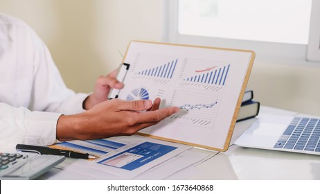 Asian business adviser meeting to analyze and discuss the situation on the financial report in the meeting room.Investment Consultant,Financial Consultant,Financial advisor and accounting concept - Shutterstock ID 1673640868