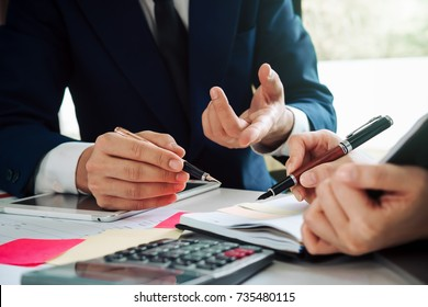 Asian business adviser meeting to analyze and discuss the situation on the financial report in the meeting room.Investment Consultant,Financial Consultant,Financial advisor and accounting concept