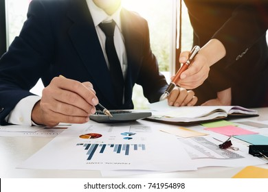 Asian business adviser meeting to analyze and discuss the situation on the financial report in the meeting room. Investment Consultant,Financial Consultant,Financial advisor and accounting concept