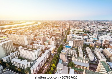 Asian Business concept for real estate and corporate construction - panoramic modern cityscape building bird eye aerial view under sunrise and morning blue bright sky in Tokyo, Japan
