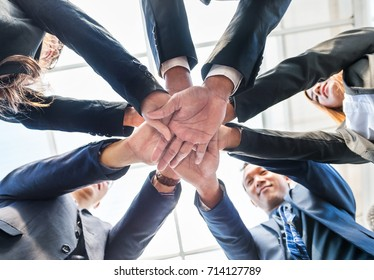 Asian business employees hug hand together. Employees teamwork is importance for work.Cooperating together on various tasks reduces workloads for all employees
