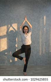 Asian business girl  practicing yoga in the office. concept relaxing on workplace
