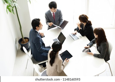 asian business group meeting
