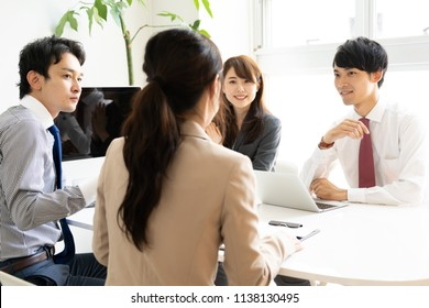 asian business group meeting in office