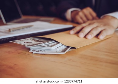 Asian business individual who owns the business sign personally sealing the deal with receiving a bribe money.The concept of corruption and anti bribery