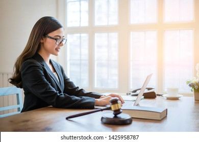 Asian business lawyer woman working with computer laptop in legal office.Law and Legal services concept.