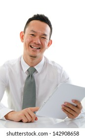 asian business male with a generic tablet sitting on a tablet