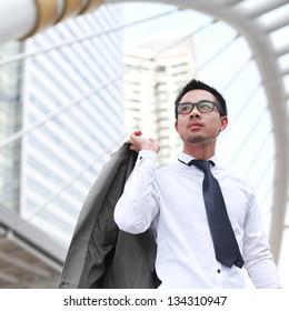 Asian business man in business center of ASEAN Economic Community - AEC