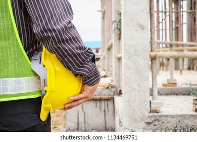 Asian business man construction engineer worker with protective helmet at house building site