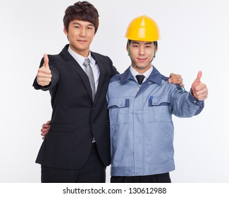 Asian business man and engineer show thumbs isolated on white