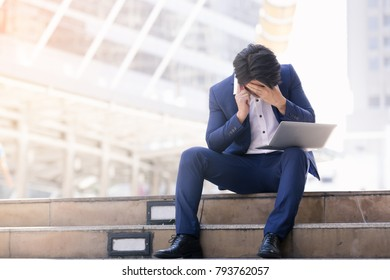 Asian business man failing and serious work on phone and laptop in the city