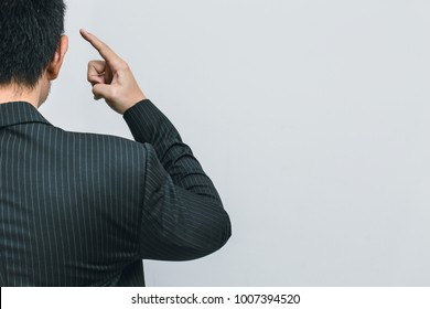 Asian business man finger at head for use his brain to thinks clever intelligent business concept.