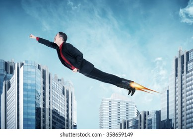 Asian business man flying with rocket on the shoes. Business challenge concept