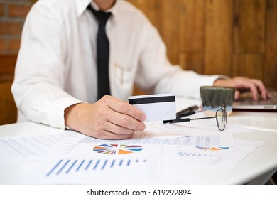 asian business man hands holding credit card and using laptop smart phone Online shopping.Online shopping concept