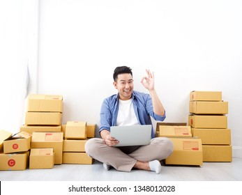 Asian business man happy with success online shopping business