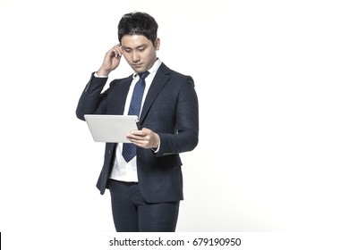 An asian business man holding a clipboard isolated white.