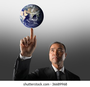 asian business man holding planet earth