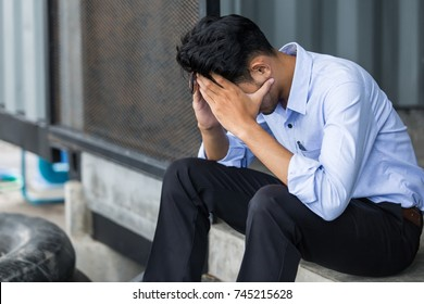 Asian Business man hopeless, hopeless, distraught, sad and discouraged in life. failing businesses Concept