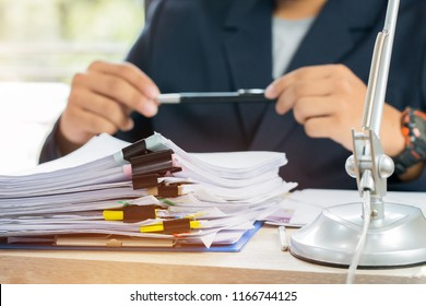 Asian Business man Manager sitting hold pen for signing applicant filling documents reports papers company application form or registering claim on office. Document Report and business busy Concept