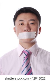 Asian business man with mouth  sealed by adhesive Tape