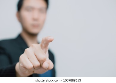 Asian business man pointing his finger to touch or order command on white space