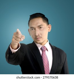 Asian business man pointing something with confident look