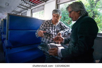 Asian business man and project manager confident in the project agreed, in train near window,