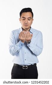Asian business man put hands together to recite prayers