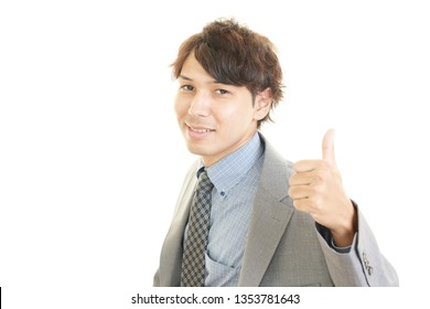 Asian business man showing thumbs up sign.