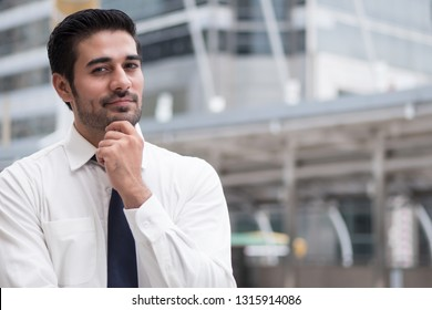 asian business man thinking; portrait of Asian, north indian successful and confident businessman thinking, planning, looking, having future project