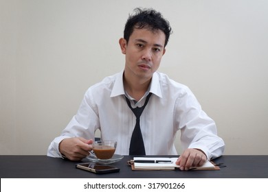 Asian business man tired at work