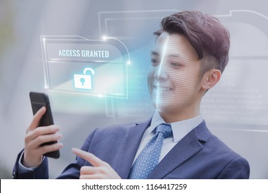 Asian business man use smart phone unlocking with biometric facial identification