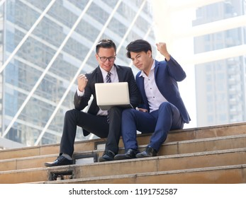 Asian business man using laptop with feeling angry sad