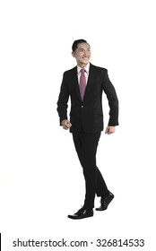 Asian business man walking isolated over white background