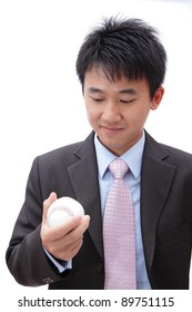 Asian Business man watch ball in the hand