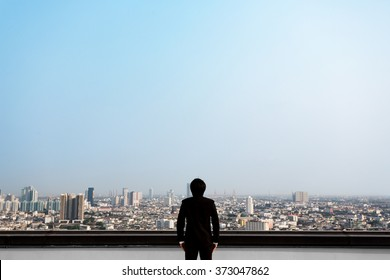 Asian business man who is looking at the city, ready for presentation retouching