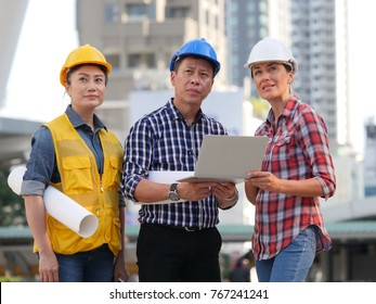 Asian business man and woman engineers architect concept
