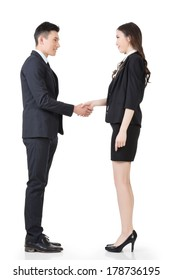Asian business man and woman shake hands, full length portrait isolated on white background.