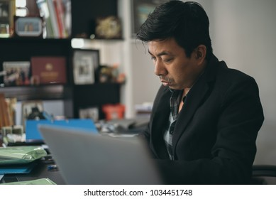 Asian business man working at home office.