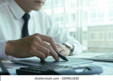 asian business man working with new startup project hand pointing graph discussion and analysis data charts and graphs and using  graphic table.Business finances and accounting concept