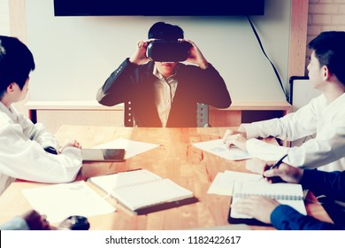 Asian business meeting with manager using virtual reality technolody headset.