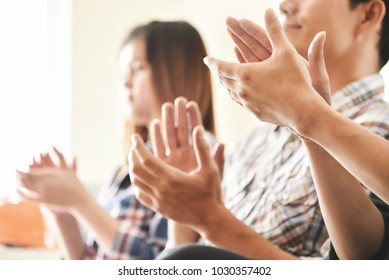 Asian business people clapping hands at conference. Meeting, seminar concepts.