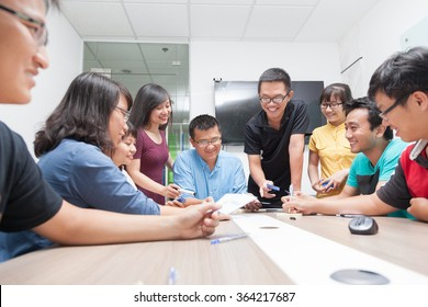 Asian business people group meeting room collaboration colleagues discussing conference desk real office team