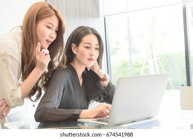 Asian business people group meeting room conference desk real office team