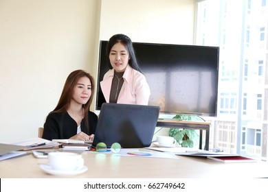 Asian business people group present and review financial marketing strategy business plan in meeting room together. Kindly supervisor train new staff in office.
