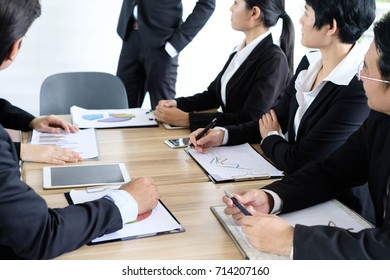 Asian business people meeting time,manager listening his staff brainstorming discussing about new start up project together in conference room at office,business colleagues teamwork concept