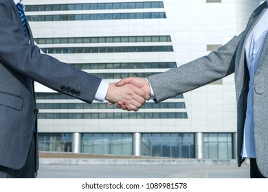 Asian business people shaking hands